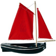 Black boat ref. 206 Red sail
